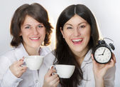 Two happy smiling young women drinking tea — Stock Photo