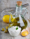 Mayonnaise with ingredients — Stock Photo