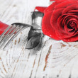 Stock Photo: Romantic dinner setting with red rose