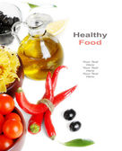 Italian cuisine - pasta, vegetables and olive oil — Stock Photo