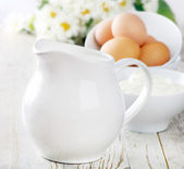 Jug with milk and eggs — Stock Photo