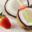 Coconut and strawberries — Stock Photo