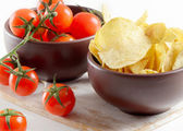 Potato chips with tomatoes — Stock Photo