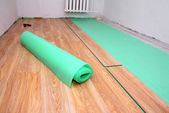 Repair in room - laying floorings — Stock Photo