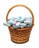 Overflowing basket with money — Stock Photo
