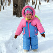 Baby girl in winter park - Stock Photo