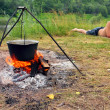 Camping - kettle and lying tourist — Stock Photo