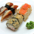 Rolls and sushi on plate — Stock Photo