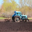 Old tractor with plough — Stock Photo