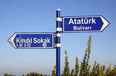 Direction signs on a post in Kemer, Turkey — Stock Photo