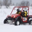 The quad bike's drivers ride over snow track — Stock Photo #9122575