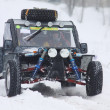 The quad bike's drivers ride over snow track — Stock Photo #9420961