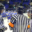 Ice-hockey referees in action - Stock Photo