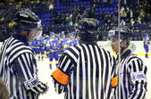 Ice-hockey referees in action — Stock Photo