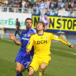 Andriy Shevchenko of Dynamo Kyiv (L) and Oleg Shelayev of Metali - Stock Photo