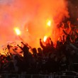 FC Dynamo Kyiv ultra supporters burn flares — Stock Photo #9556770