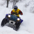 The quad bike's driver rides over snow track — Foto de Stock