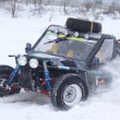 The quad bike's drivers ride over snow track - Stock Photo