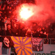 FC Dynamo Kyiv ultras (ultra supporters) burn flares - Stock Photo