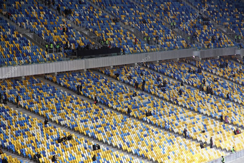 KYIV, UKRAINE - NOVEMBER 11, 2011: fill the tribunes at the Olympic stadium (NSC Olimpiysky) before friendly football game between Ukraine and Germany on November 11, 2011 in Kyiv, Ukraine — Stock Photo #9630712