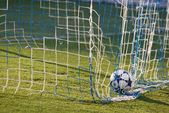 Soccer ball inside the net — Stock Photo