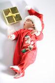 Baby in santa wear — Stock Photo