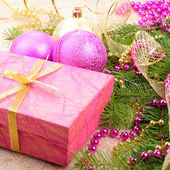 Christmas gold and pink with pine branch — 图库照片