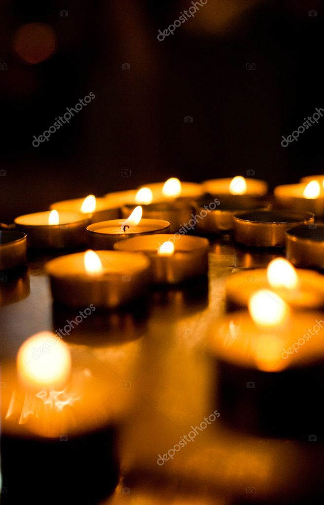 Burning candles in the church. Shallow DOF  Stock Photo #8958854