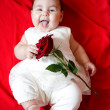 Cute girl with red rose — Stock Photo #9899505