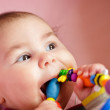 Baby are gnawing a toy — Stock Photo #9899591