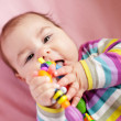 Baby are gnawing a toy — Stock Photo #9899597