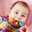 Baby are gnawing a toy — Stock Photo #9899659