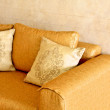 Nice orange sofa with pillows — Stock Photo