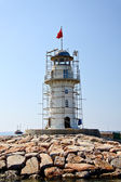 Lighthouse in port. Turkey, Alanya. Sunny weather. — Stock Photo