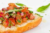 Bruschetta( Italian Toasted Garlic Bread ) with tomato — Stock Photo
