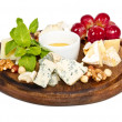 Various types of cheese with honey, nuts and grapes on plate, is — Stock Photo #9220257