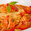 A plate of linguini with sauteed shrimp, tomato, chili  and oliv - Stock Photo