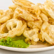 Golden deep fried onion rings — Stock Photo