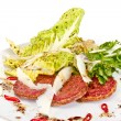 Salad from fried sausages, lettuce with sour cream sauce — Stock fotografie