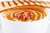 Pumpkin soup with bacon and dread — Stock Photo