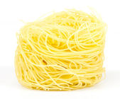 A portion of tagliatelle italian pasta isolated on white — Stock Photo