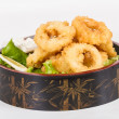 Deep batter fried squid rings calamari with green salad — Stok fotoğraf