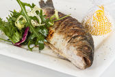 Sea-bass with vegetables — Stock Photo