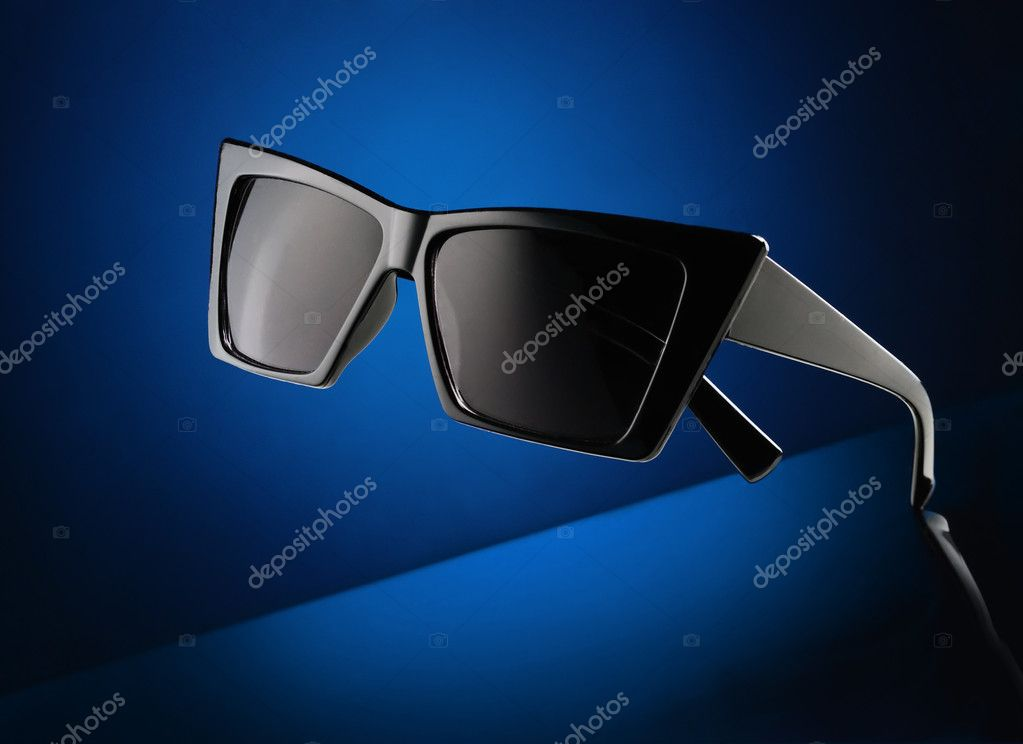 Closeup trendy sunglasses on the dark blue abstract background  Stock Photo #8923707