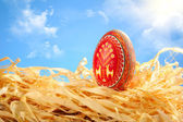Easter egg painted on sky background — Stock Photo