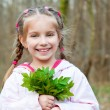 Cute little girl  on the wood — Stock Photo