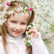 Little girl with bush blossoming — Stock Photo