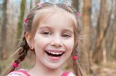 Cute little girl on the wood — Stock fotografie