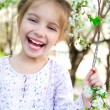 Little girl with bush blossoming - Foto de Stock