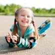 Little girl in roller skates — Stock Photo #10551856